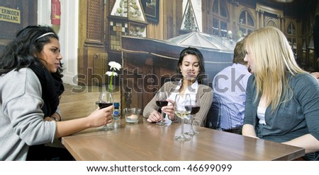 A group of girls having a drink in a cafe