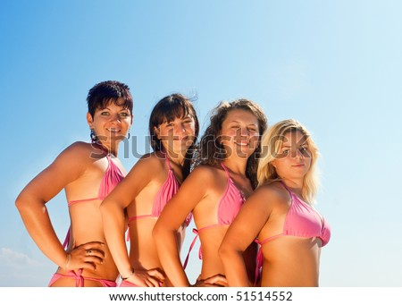 a group of happy young girls posing in sexy bikinis