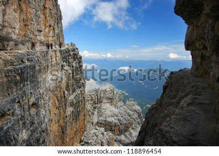 "A group of hikers going ""via ferrata"" along the rock edge - Dolomiti mountains, Dolomiti di Brenta, Italy"