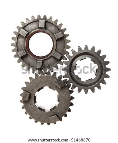 A group of interlocking metal gears on a white background. - stock photo