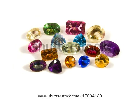 a group of large faceted gemstones on a white background - stock photo