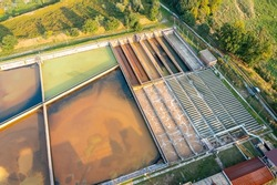 A group of large sedimentation tanks. Water settling, cleaning in a reservoir with biological organisms at a water station. different degree of wastewater treatment