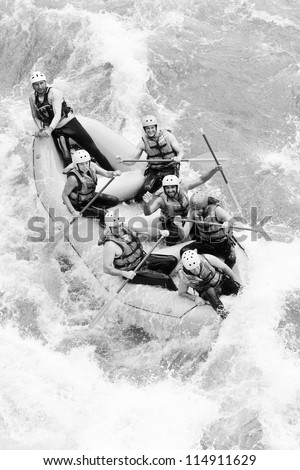 A group of men and women, with a guide, white water rafting on the Pastaza river, Ecuador ,aerial shot