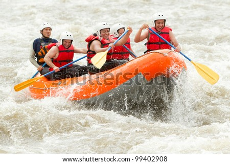 A group of men and women with a guide white water rafting on the Patate river Ecuador
