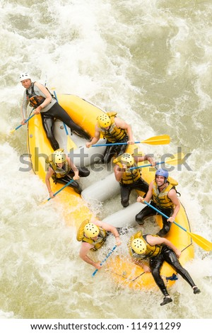 A GROUP OF MEN AND WOMEN, WITH A GUIDE, WHITEWATER RAFTING ON THE PASTAZA RIVER, ECUADOR, AERIAL SHOT