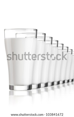 a group of milk glasses in row, a lot of milk glasses in row - stock photo