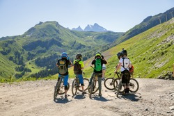 A group of mountain bikers at mountain top before descent, France