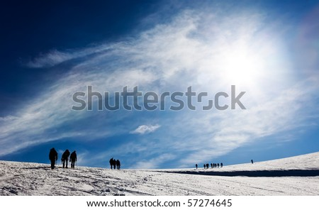 A group of mountaneers walking on a glacier in a sunny day, Monte Rosa range, West Alps, Switzerland, Europe.