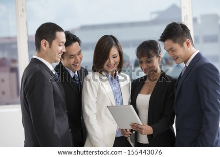 A group of muliethnic Business people using a digital tablet in the office.
