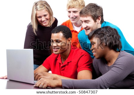 A group of multi-racial college students/friends sitting around a computer