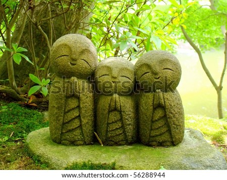 A group of Nagomi-Jizo, symbol of relaxation in the Buddhist temple Hasedera, Kamakura, Japan