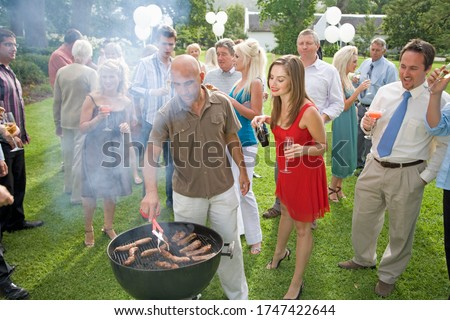 A group of people at a summer barbeque