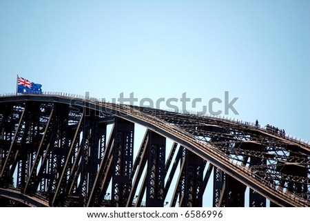 A group of people climbing up the sydney harbour bridge.