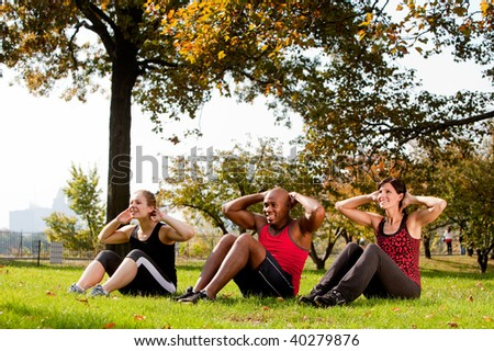 A group of people doing exercises in the park