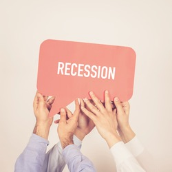 A group of people holding the Recession written speech bubble