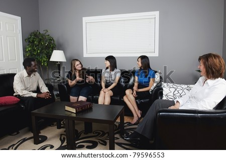 Living Room on Group Of People Talking In A Living Room Stock Photo 79596553