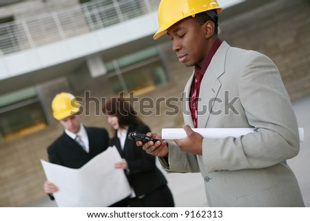 A group of people working as  architects on a construction site