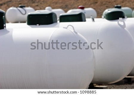 A group of Propane tanks at a Propane business located in rural America (focus point on foreground tank, shallow focus).