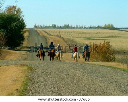 A group of ranch folks on their way to get the cows.
