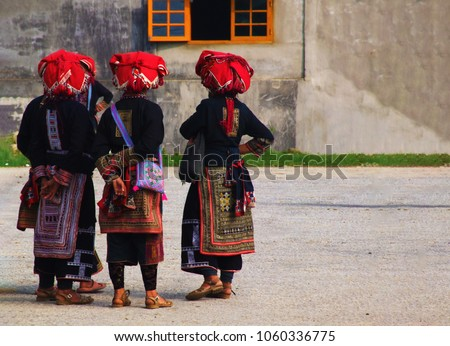 A group of Red Dao ethnic minority women in a village near Sapa, Vietnam