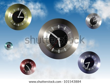 a group of round metal clocks with a blue sky in the background / clocks