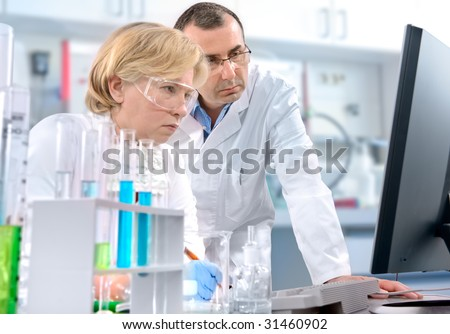 a group of scientists working at the laboratory