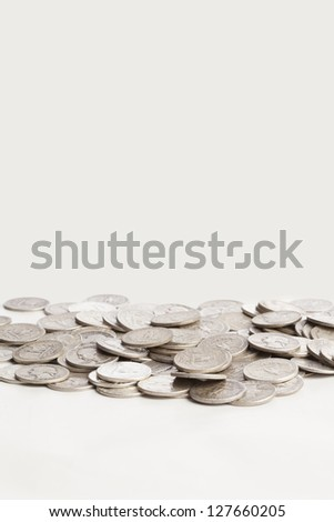 A group of shiny pure silver coins are shown on a white background