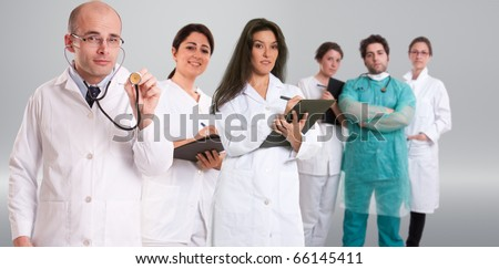 A group of six healthcare professionals in different attitudes - stock photo