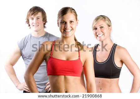 A group of smiling friends in athletic clothing, midrifts exposed.