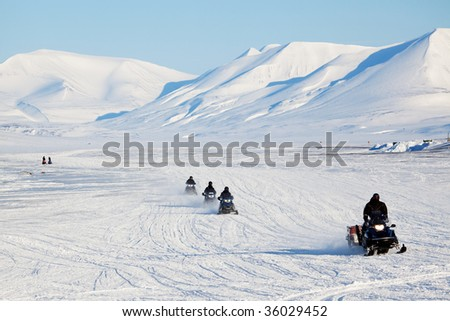 A group of snowmobiles on the ice outside Longyearbyen, Svalbard Norway Сток-фото ©