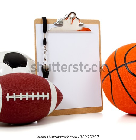 A group of sports ball with a blank clipboard including a basketball an American football and a soccer ball on white