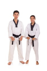 A group of tae-kwon-do athletes standing over white background background, full length portrait