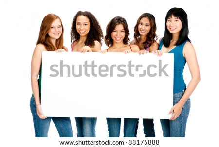 A group of teenagers with diverse ethnicities holding up a blank sign against white background