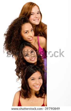 A group of teenagers with diverse ethnicities looking at a blank space against white background