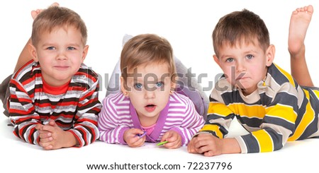 A group of three little lying children; isolated on the white background