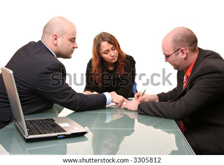 A group of three signing a contract. Isolated on a white background