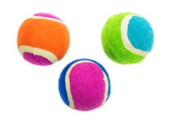 A group of three small rubber fetch balls for dogs on a white background.