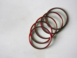 A group of traditional red glass bangles isolated on white background