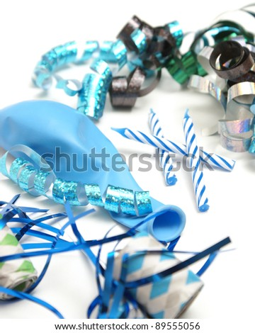 A group of various blue party supplies on a white background.
