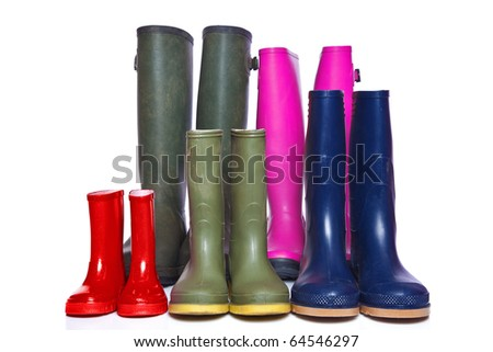 A group of wellie boots isolated on a white background.