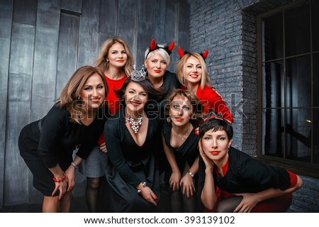 A group of  women posing in the photo studio. Celebrate the birthday.  female, people, togethe,  portrait, smile, beautiful, fun, cheerful, friendship, black, white, red, horns, hen-party