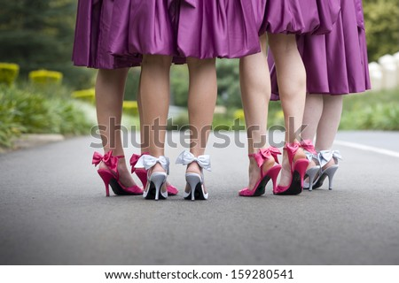 a group of women wearing bow high heels and purple skirts