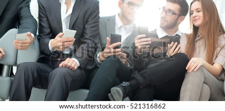 A group of young and happy young people using their phones and c - Shutterstock ID 521316862