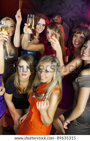 A group of young beautiful people dancing at a disco. New Year