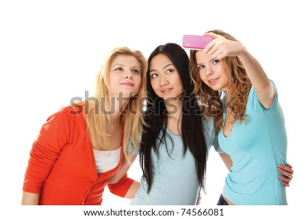 A group of young college girls taking photo