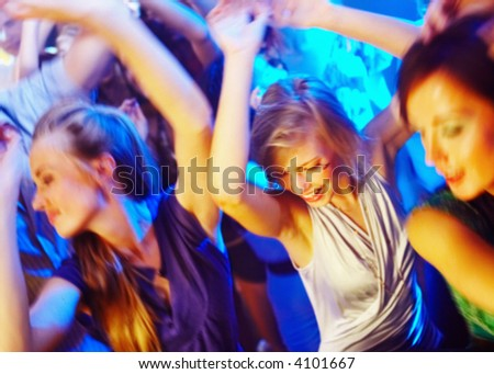 stock photo : A group of young people dancing at a disco. - Attention buyers