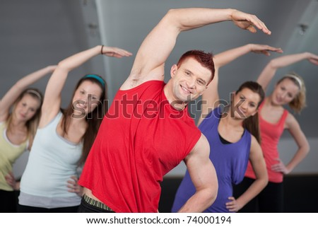 A group of young people stretching at a health club