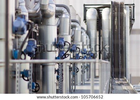 A group pipes and valves in modern factory - stock photo