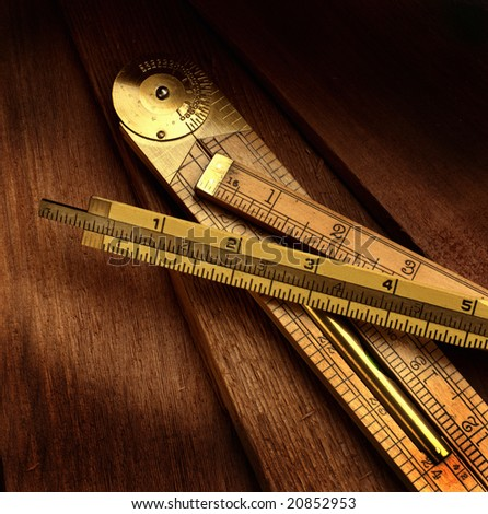 A grouping of wooden rulers used in construction