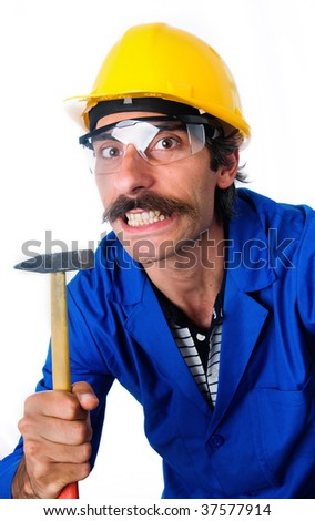 A growling carpernter/construction worker wearing a yellow hard hat, safety goggles and a blue jumpsuit with a small hammer in his hand.